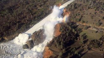 A damaged spillway with eroded hillside is seen in an aerial photo taken over the Oroville Dam in Oroville, California, U.S. February 11, 2017.  California Department of Water Resources/William Croyle/Handout via REUTERS  ATTENTION EDITORS - THIS IMAGE WAS PROVIDED BY A THIRD PARTY. EDITORIAL USE ONLY. THIS PICTURE WAS PROCESSED BY REUTERS TO ENHANCE QUALITY. AN UNPROCESSED VERSION HAS BEEN PROVIDED SEPARATELY.    TPX IMAGES OF THE DAY