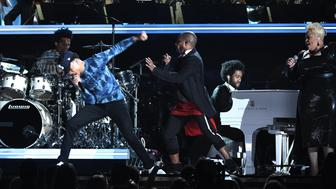 LOS ANGELES, CA - FEBRUARY 12:  Recording artists Chance The Rapper (L) and Kirk Franklin perform onstage during The 59th GRAMMY Awards at STAPLES Center on February 12, 2017 in Los Angeles, California.  (Photo by Kevork Djansezian/Getty Images)