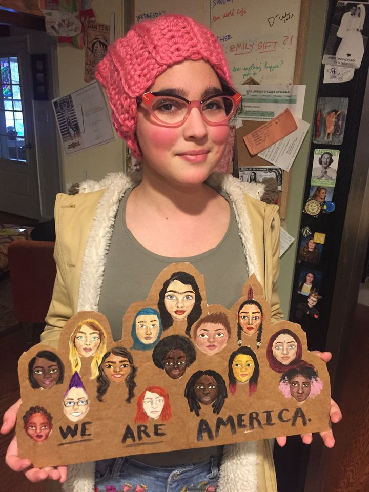My oldest on her way to DC with the poster she painted.
