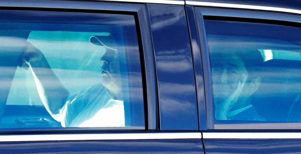 Abe, right, and Trump are seen in the presidential limousine as they depart from Trump International Golf Club in West Palm B