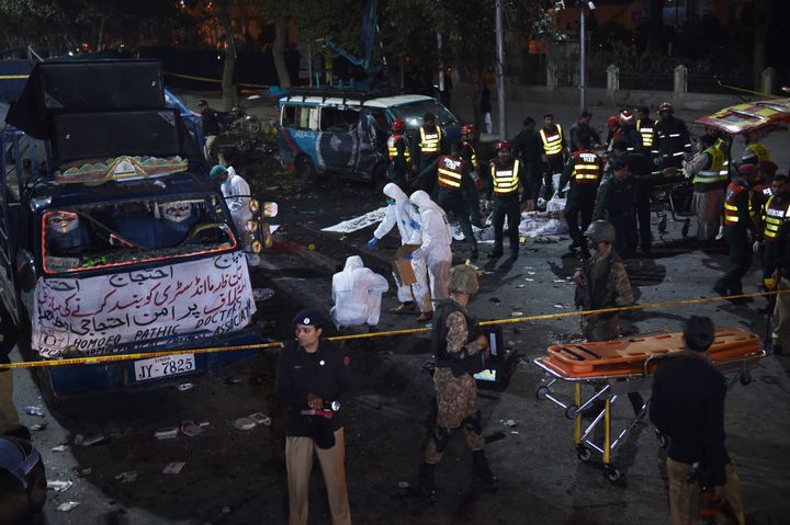 Pakistani security officials inspect the site after a powerful explosion in Lahore on February 13, 2017.