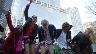 Activists gather across from Trump Tower before pulling down their pants and mooning on February 12, 2017 in Chicago, Illinois. The event was staged to protest the policies of President Donald Trump and to demand that he release his tax information. (Photo by Patrick Gorski/NurPhoto via Getty Images)