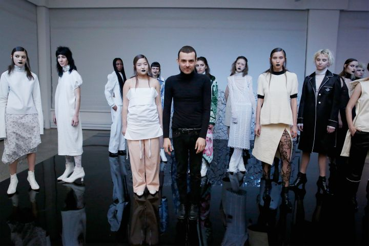 Fashion designer Luis Raul Solis (C) poses at the LRS Studio presentation on Feb. 10 in New York City.