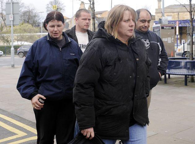 Julie Bushby (front), friend of Karen Matthews, pictured outside Dewsbury Magistrates Court eight years