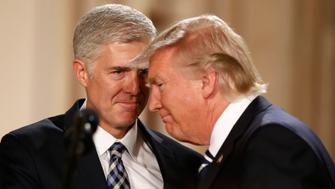 U.S. President Donald Trump and Neil Gorsuch (L) smile as Trump nominated Gorsuch to be an associate justice of the U.S. Supreme Court at the White House in Washington, D.C., U.S., January 31, 2017.  REUTERS/Kevin Lamarque