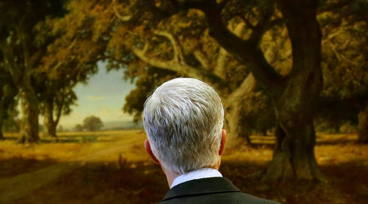 Supreme Court nominee Neil Gorsuch looks at a landscape painting in Sen. Dianne Feinstein's Washington office as he arri