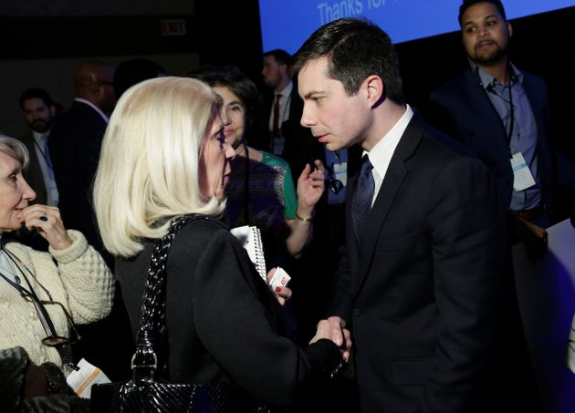 Pete Buttigieg speaks to a supporter after a Democratic National Committee forum in Baltimore on Feb....
