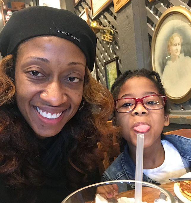 Marissa Alexander eats breakfast with her daughter Rihanna on her first day off house arrest.