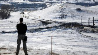 A police officer monitors the outskirts of the Dakota Access oil pipeline protest camp near Cannon Ball, North Dakota, U.S., January 29, 2017. REUTERS/Terray Sylvester