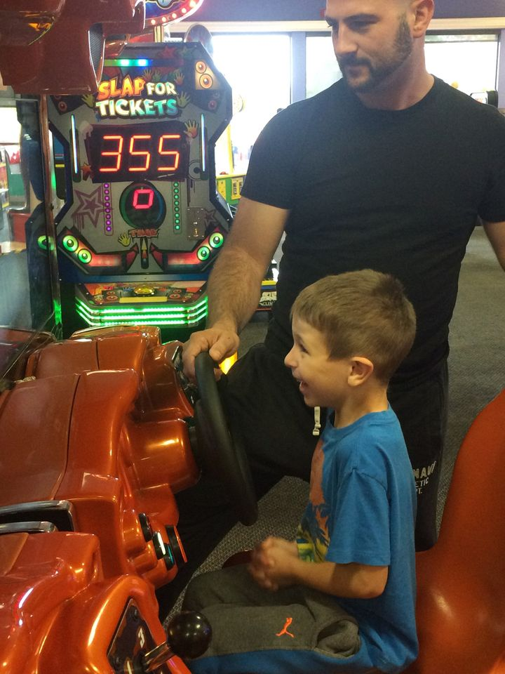 Mike Moniz and his son, Austin, at a Chuck E. Cheese's Sensory Sensitive Sundays event.
