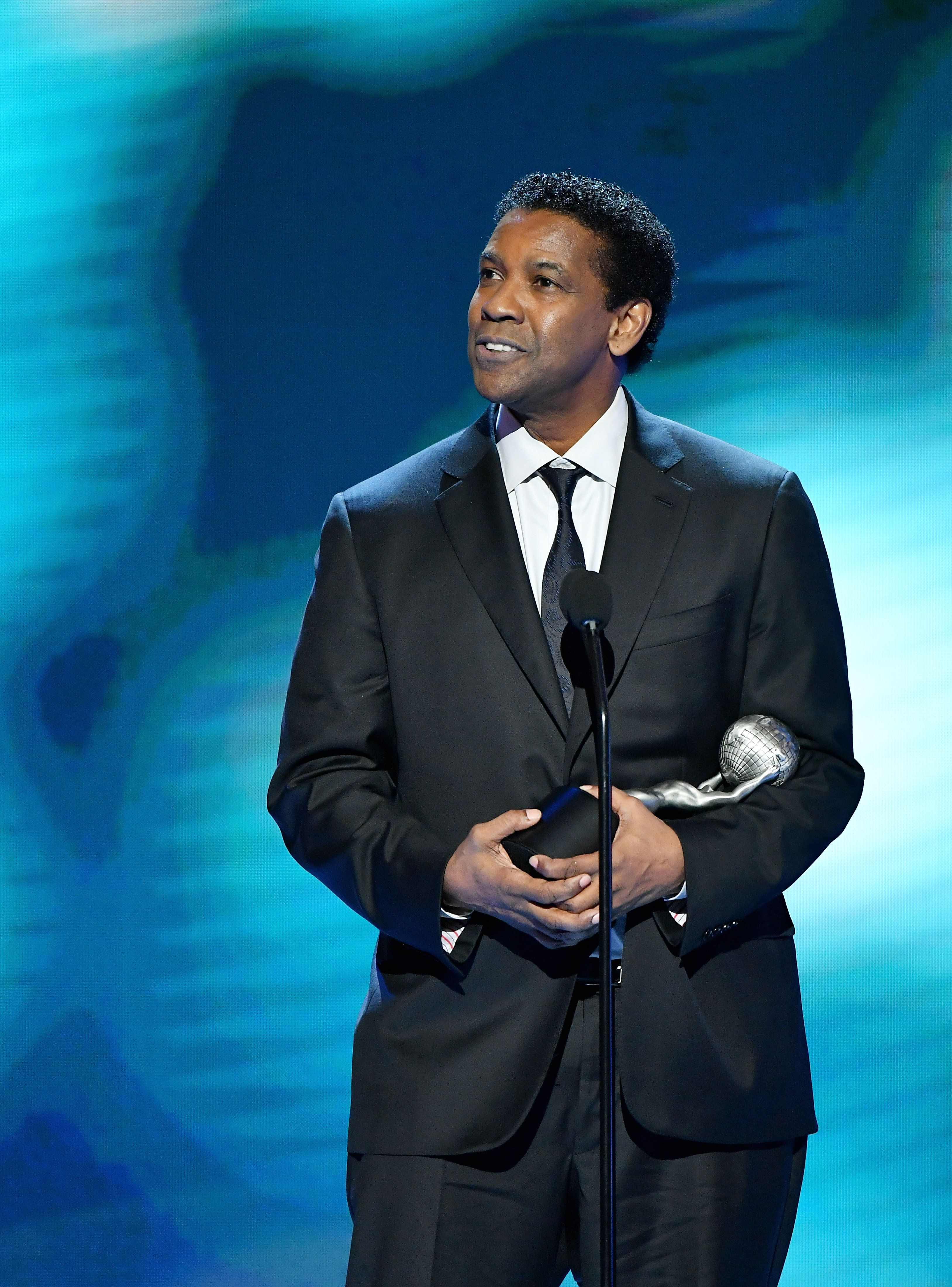 PASADENA, CA - FEBRUARY 11:  Actor Denzel Washington accepts award for Outstanding Actor in a Motion Picture onstage at the 48th NAACP Image Awards at Pasadena Civic Auditorium on February 11, 2017 in Pasadena, California.  (Photo by Earl Gibson III/WireImage)
