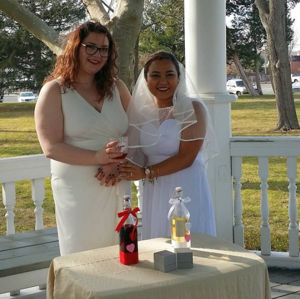 """Congratulations, Erin and Jean! We had a beautiful ceremony at Spring Lake Park gazebo. Their ceremony included a unity wine"