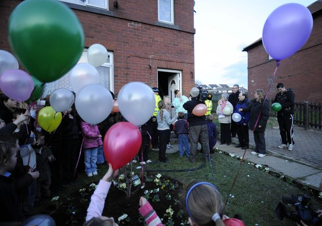 Karen Matthews talks on the microphone after planting flowers in her garden with local children at Moorside...
