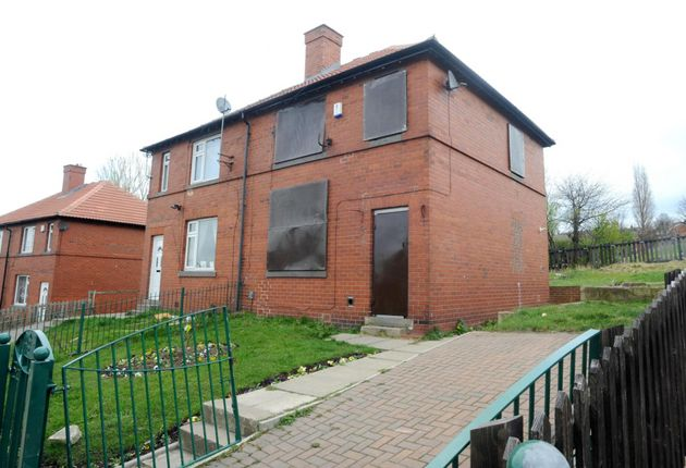 A general view showing the now boarded up former home of Shannon Matthews in Dewsbury Moor, West Yorkshire....