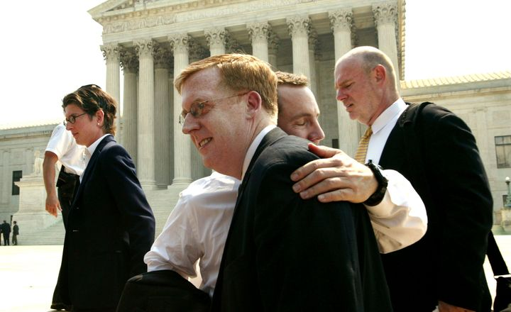 Bill Hohengarten and Paul Smith, attorneys for plaintiffs John Lawrence and Tyron Garner, hug outside the U.S. Supreme Court