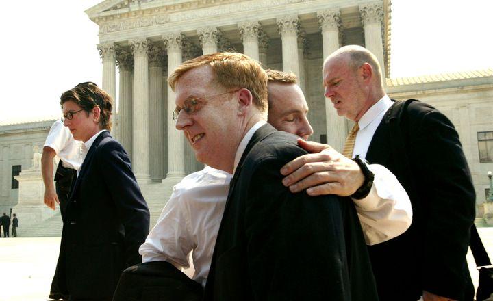 Bill Hohengarten and Paul Smith, attorneys for plaintiffs John Lawrence and Tyron Garner, hug outside the U.S. Supreme Court