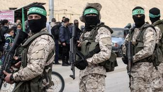 Members of the Ezzedine al-Qassam Brigades, the military wing of the Palestinian Islamist movement Hamas, attend a memorial in the southern Gaza Strip town of Rafah on January 31, 2017, for Mohamed Zouari, a 49-year-old Tunisian engineer and drone expert, who was murdered at the wheel of his car outside his house in Tunisia in December 2016.  The armed wing of Hamas said that the Jewish state was responsible for the murder in eastern Tunisia, of Mohamed Zaouari, described as a leader of the Islamist movement specializing in the development of drones. / AFP / SAID KHATIB        (Photo credit should read SAID KHATIB/AFP/Getty Images)