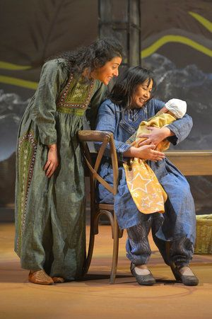 Laila (Nadine Malouf) and Mariam (Kate Rigg) tend to baby Azizah in a scene from <strong><em>A Thousand Splendid Suns</em></s