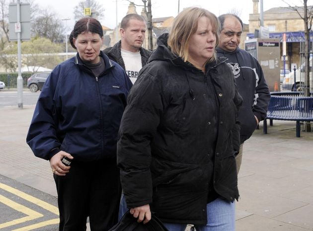 Julie Bushby (front), friend of Karen Matthews, outside Dewsbury Magistrates Court  eight years