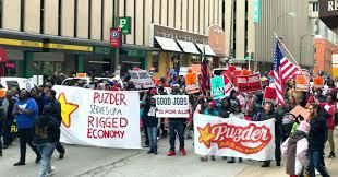 Fast food workers march against Puzder in St. Louis, Missouri.