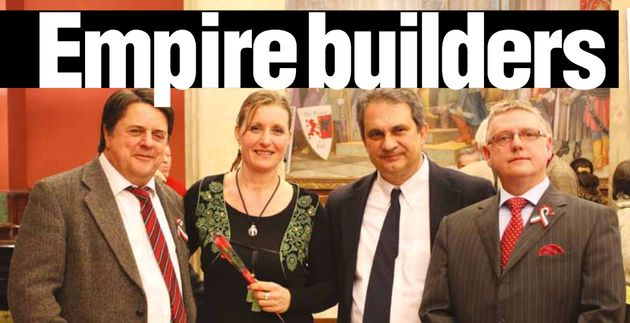 Former British National Party leader Nick Griffin, left, pictured at the Reform Church in Budapest along...
