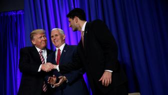 U.S. President Donald Trump is greeted by Vice President Mike Pence and House Speaker Paul Ryan (R) as he arrives to speak at a congressional Republican retreat in Philadelphia, U.S. January 26, 2017.  REUTERS/Jonathan Ernst     TPX IMAGES OF THE DAY