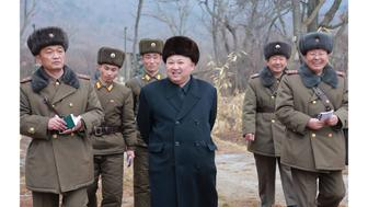 This undated picture released from North Korea's official Korean Central News Agency (KCNA) on January 19, 2017 shows North Korean leader Kim Jong-Un (C) inspecting a sub-unit under KPA Unit 233 at an undisclosed location. North Korea is preparing to test new rockets, a report said on January 19, after its leader Kim Jong-Un said the country was in the final stages of developing inter-continental ballistic missiles. / AFP / KCNA VIA KNS / STR / South Korea OUT / REPUBLIC OF KOREA OUT   ---EDITORS NOTE--- RESTRICTED TO EDITORIAL USE - MANDATORY CREDIT 'AFP PHOTO/KCNA VIA KNS' - NO MARKETING NO ADVERTISING CAMPAIGNS - DISTRIBUTED AS A SERVICE TO CLIENTS THIS PICTURE WAS MADE AVAILABLE BY A THIRD PARTY. AFP CAN NOT INDEPENDENTLY VERIFY THE AUTHENTICITY, LOCATION, DATE AND CONTENT OF THIS IMAGE. THIS PHOTO IS DISTRIBUTED EXACTLY AS RECEIVED BY AFP.  /         (Photo credit should read STR/AFP/Getty Images)