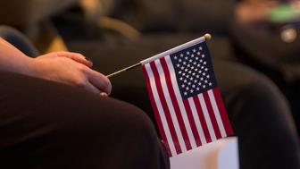 BOSTON, MA - FEBRUARY 08:  A woman holds an American flag during a Naturalization Oath Ceremony at the John F. Kennedy Presidential Library and Museum on February 8, 2017 in Boston, Massachusetts.  (Photo by Scott Eisen/Getty Images)