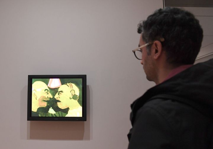 A man looks at artwork by Iranian artist Tala Madani 'The Chit Chat, 2007' at The Museum of Modern Art on February 3, 2017 in