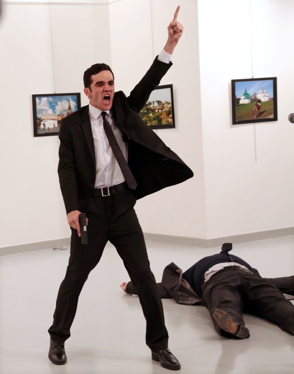Mevlut Mert Altintas shouts after shooting Andrei Karlov, right, the Russian ambassador to Turkey, at...