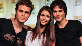 SAN DIEGO, CA - JULY 14:  (L-R) Actors Paul Wesley, Nina Dobrev and Ian Somerhalder attend the 'Vampire Diaries' panel at San Diego Convention Center on July 14, 2012 in San Diego, California.  (Photo by Chelsea Lauren/WireImage)