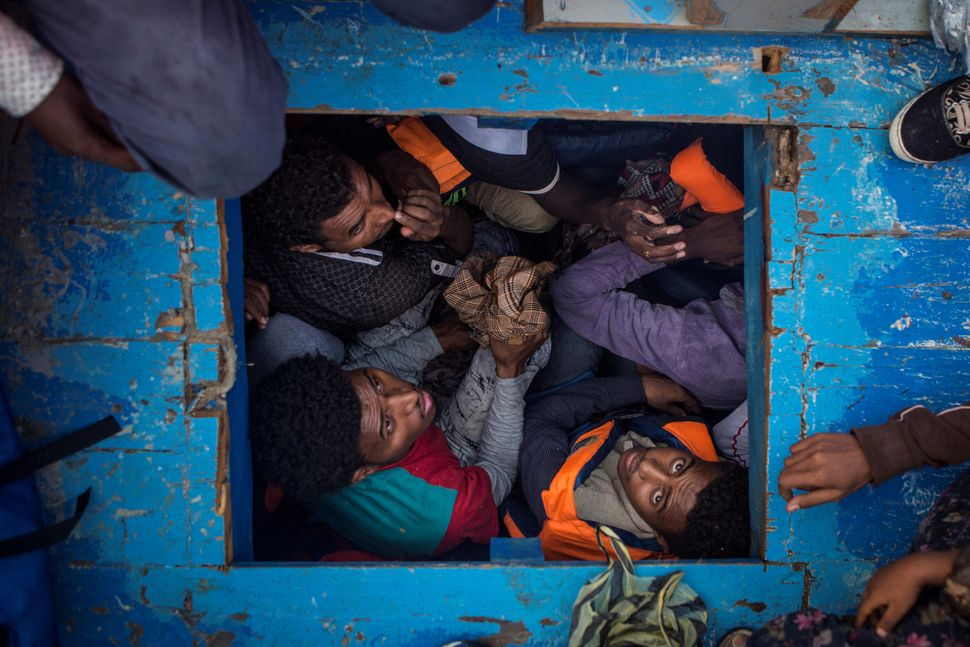 Eritrean migrants seen cramped in the hold of a large wooden boat, which carried approximately 540 men women and children, mo