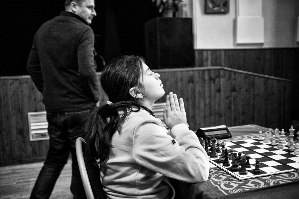 The chess player concentrates just a few moments before the start of the next round of a tournament. Chess, for some, represe