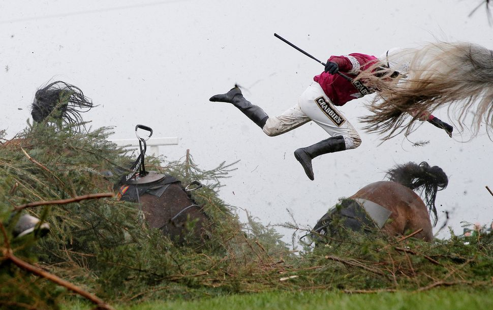 Jockey Nina Carberry flies off her horse Sir Des Champs as they fall at The Chair fence during the Grand National steeplechas