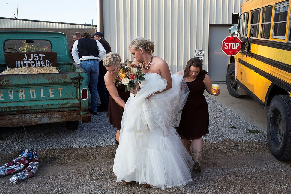 Kelly Freeman arrives at her wedding reception in Dubois, Kansas.