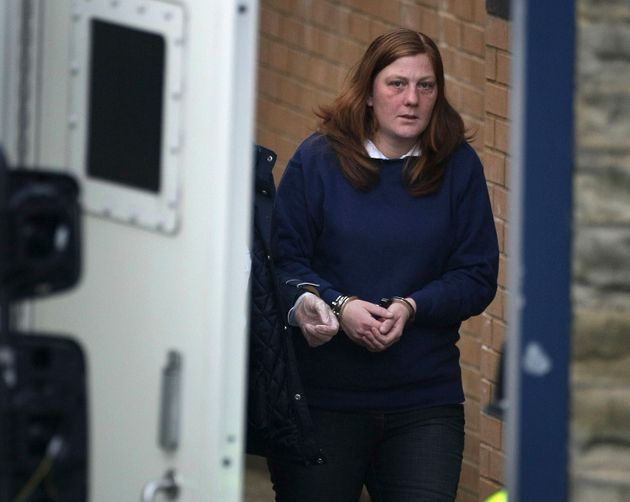 A handcuffed Karen Matthews, the mother of Shannon Matthews, leaves Dewsbury Police Station today to...