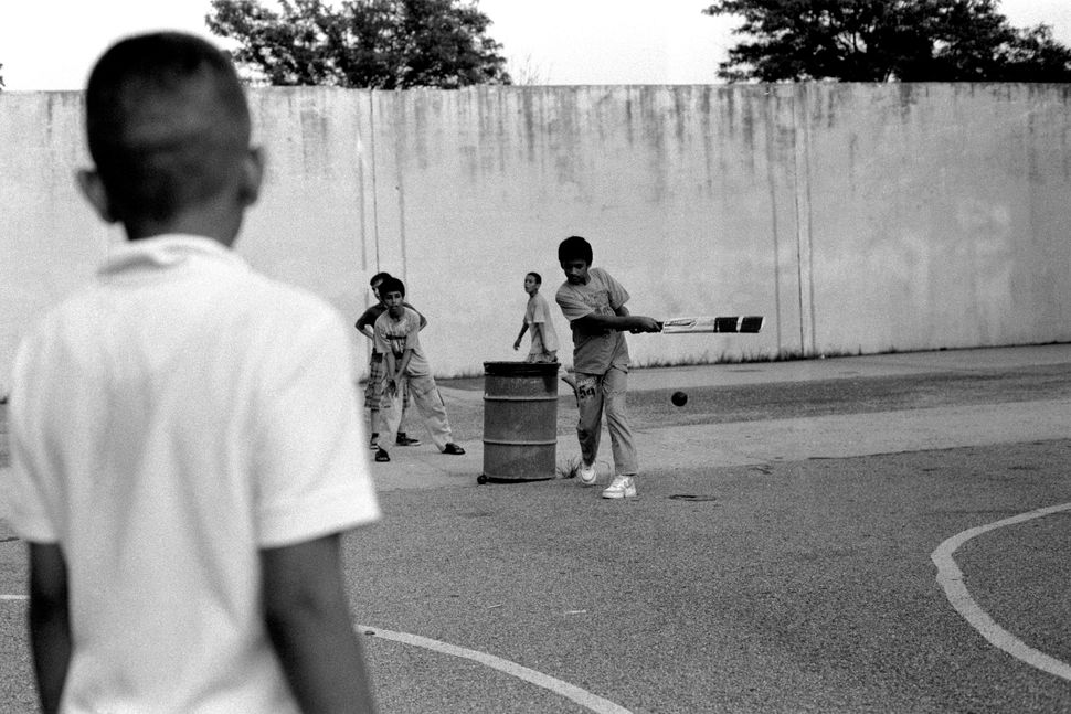 "Robert Gerhardt, ""Pakistani American Children Playing Cricket in the Park, Brooklyn, NY,"" 2011."