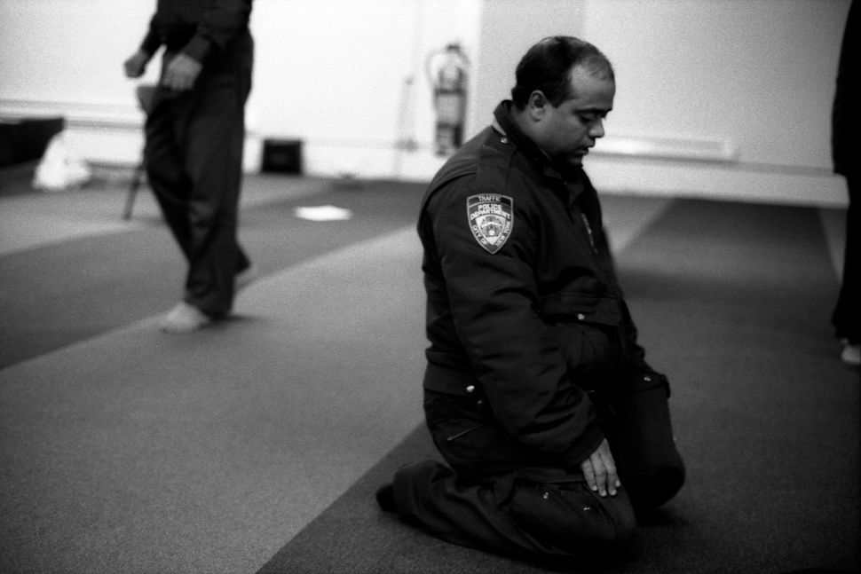 "Robert Gerhardt, ""NYPD Traffic Officer at Prayers, Park 51,"" Manhattan, New York, 2012."