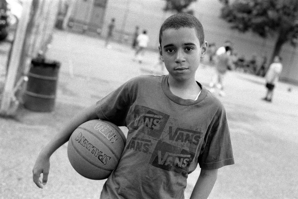 "Robert Gerhardt, ""Young Basketball Player in the Park before Friday Prayers,"" Brooklyn, New York, 2011."