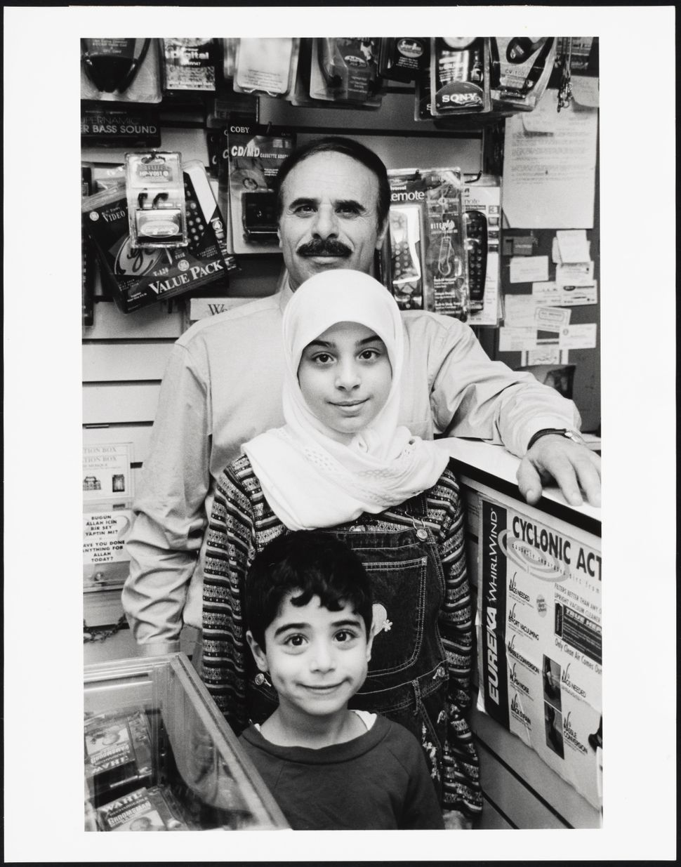 "Mel Rosenthal, ""B & B Electronics Store Owner with children, Bay Ridge, Brooklyn,"" 1999."