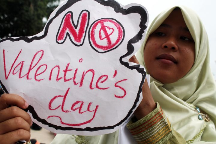Muslim activists hold posters as they support a ban on Valentine's Day on Feb. 14, 2016 in Medan, Indonesia.