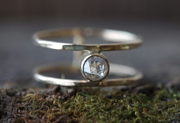 """<i>Buy it <a href=""""http://www.alexisrussell.com/collections/bridal/products/new-cage-ring"""" target=""""_blank"""">here</a> for $418."""