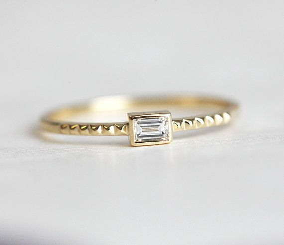 """<i>Buy it <a href=""""https://www.etsy.com/listing/267910009/diamond-engagement-band-delicate"""" target=""""_blank"""">here</a> for $650"""