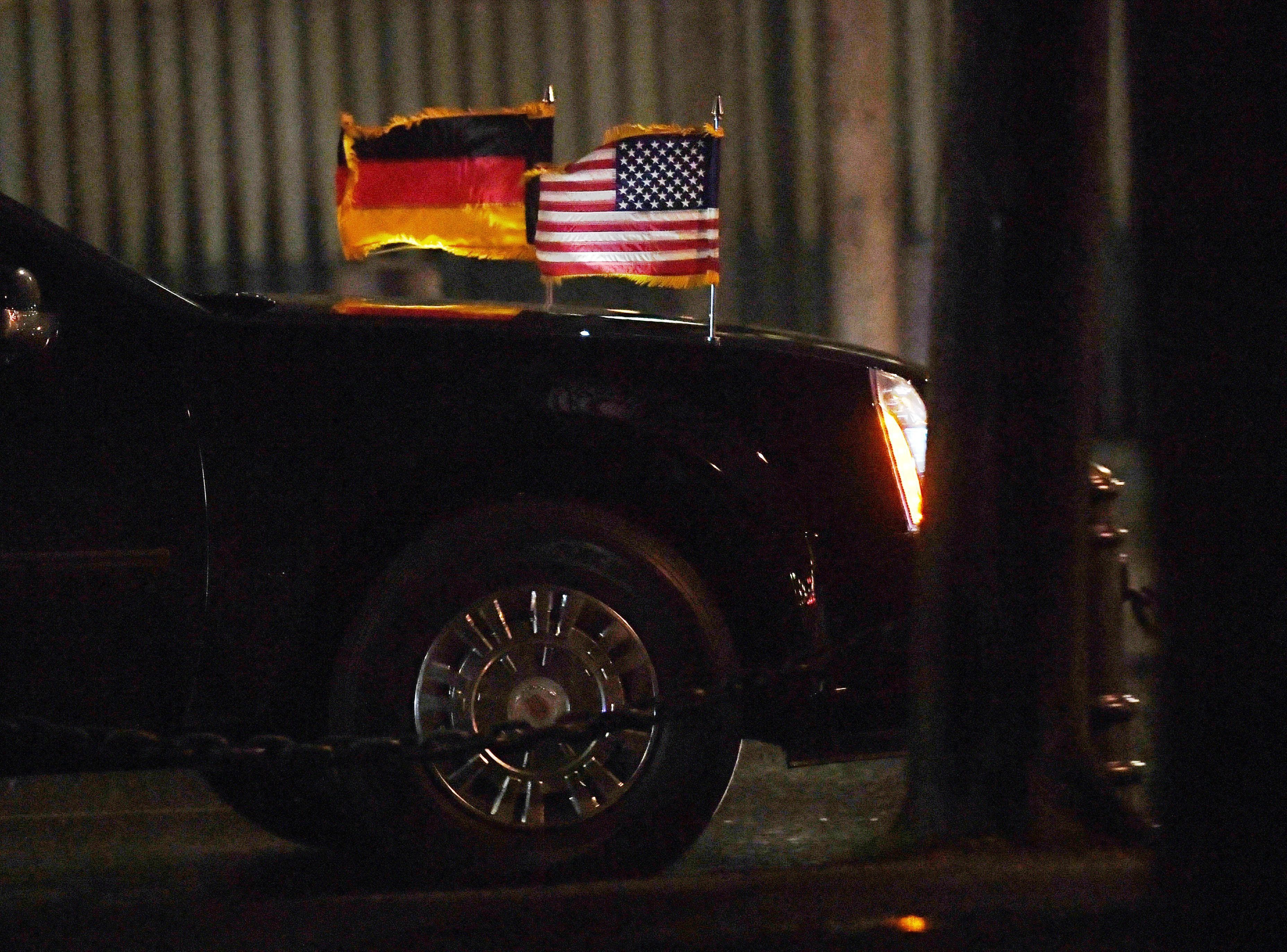 The German and US flags fly on the car of US President Barack Obama as it makes its way towards the Adalon Hotel on November 16, 2016. US President Barack Obama pays a farewell visit to German Chancellor Angela Merkel, widely seen as the new standard bearer of liberal democracy since the election of Donald Trump. / AFP / dpa / Ralf Hirschberger / Germany OUT        (Photo credit should read RALF HIRSCHBERGER/AFP/Getty Images)