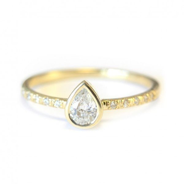 """<i>Buy it <a href=""""http://sillyshiny.com/shop/unique-engagement-rings/minimalist-delicate-pear-diamond-engagement-ring.html"""""""