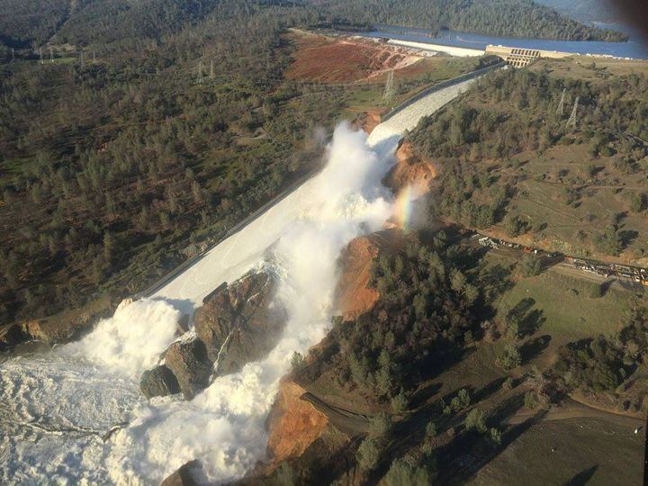 A damaged spillway with eroded hillside is seen in an aerial photo taken over the Oroville Dam in California on Feb. 11.