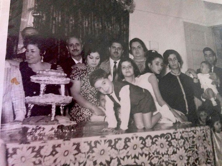 Me on the table at my two-year-old birthday party in Damascus - Syria.