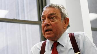 Television news anchor Dan Rather speaks during an interview in New York, November 7, 2006. REUTERS/Keith Bedford (UNITED STATES)