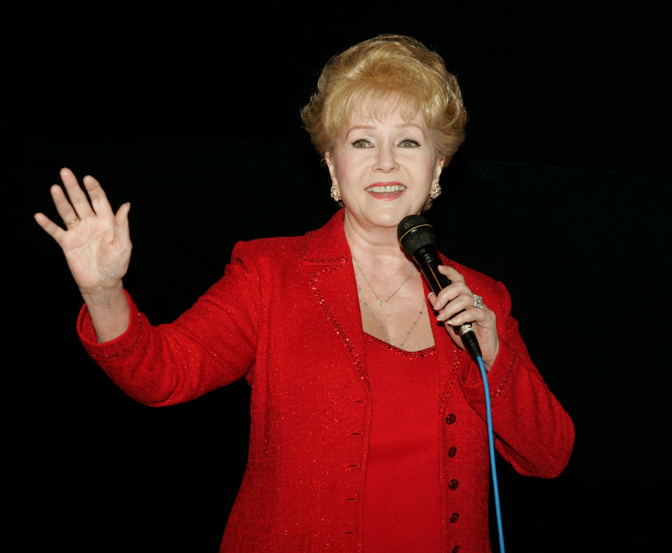 """Actress Debbie Reynolds speaks at the """"Hollywood Stars Salute Glenn Ford's 90th Birthday"""" held on the actor's 90th birthday May 1, 2006, during a salute and screening of Ford's 1946 film """"Gilda"""" by the American Cinematheque at Grauman's Egyptian Theatre in Hollywood. Reynolds starred with Ford in the 1959 film """"The Gazebo"""". Ford was expected in person, but his doctor advised against him attending. REUTERS/Fred Prouser"""
