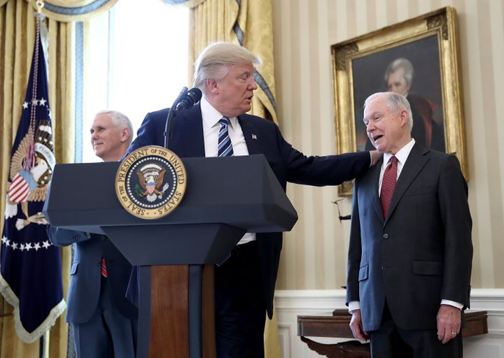 President Donald Trump with Attorney General Jeff Sessions at his swearing in ceremony in the Oval Office. Sessions was the f